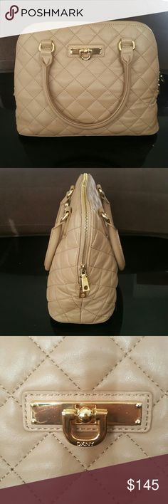 DKNY Handbag Soft quilted leather crossbody handbag Features: Crossbody adjustable strap 3 interior pockets (2 open and 1 zippered) Signature hanging D lock Gold hardware and 4 feet on bottom of bag DKNY Bags Crossbody Bags