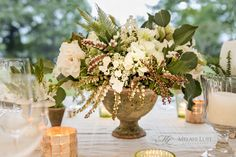 Floral centerpiece for a tented garden wedding. Rustic charm in creams, whites and greens by KDJ Botanica, in urn. ©MelaniLustPhotography.