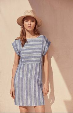 Crisp stripes intersect on a relaxed linen shift, lending Americana cool to a warm-weather staple.