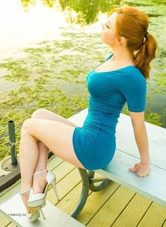 This woman has a spring tone with her paleish skin and red hair. Aqua is one of the main colors that pair well with springs. This woman was successful in picking an aqua colored dress. Blues are cool and tranquilizing.