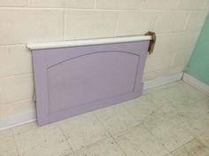 White and purple twin size headboard.