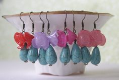 4 Pairs of Turquoise and Flower Earrings Turquoise Earrings Red Rose Earrings Pink Flower Earrings Spring Earrings Lucite Flower Earrings. $24.95, via Etsy.