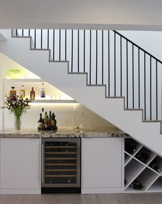 Coral Gables home's staircase with bar underneath Bar Under Stairs, Under Stairs Wine Cellar, Kitchen Under Stairs, Space Under Stairs, Under Staircase Ideas, Home Stairs Design, House Design, Staircase Storage, Stair Storage