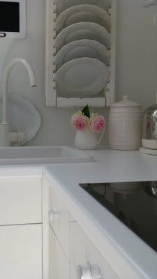 Repurpose a shutter as a plate rack