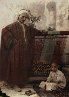 Africa: Colored old photo, Berber father and child, Tunisia