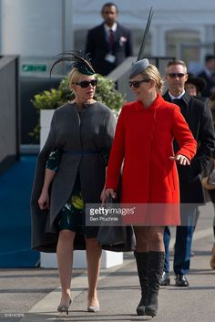 Zara Phillips (R) walks through the racecourse during St Patrick's Day at the Cheltenham Festival at Cheltenham Racecourse on March 17, 2016 in Cheltenham, England. The four day annual jump racing event sees jockeys compete for a piece of the 4.1 million GBP of the prize money.  (Photo by Ben Pruchnie/Getty Images)