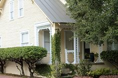 Love this yellow cottage on Greene Square! The front porch is such a treat!