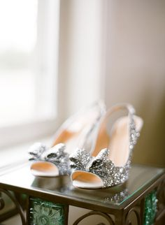 The bride's sparkly silver wedding heels by Kate Spade... absolute perfection! As seen on BRIDES. >> Photo by The McCartneys Photography www.meetthemccartneys.com