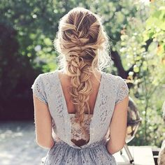 This one might look complicated at first but it's pretty simple. Start with a full french braid and then pull some parts of your hair and the loops loose. The end result is a beautiful mess.