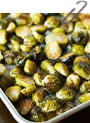 Roasted Garlic Brussels Sprouts - brussel sprouts tossed in olive oil and garlic powder then roasted to perfection!