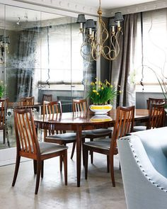 Love the white riveted chair and the mirror wall, not a fan of the table though.