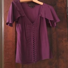 Elizabeth and james flirty silk blouse. Elizabeth and James 100% silk short sleeve blouse. Flutter sleeves. Two small spots as shown; one on the back and one less visible on the front. Elizabeth and James Tops Blouses