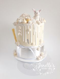Silver and yellow bunny drip cake. By Jenelle's Custom Cakes.