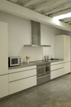 Like white kitchen, stainless steel, polished concrete (& ceiling).