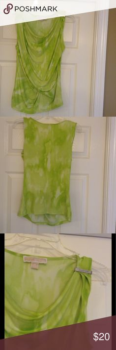 Adorable Michael Kors Tie-Dye Look Top Adorable sleeveless green top that drapes beautifully with low neck, shoulder has a beautiful silver Michael Kors silver bar across it, excellent condition.  Top is dark and light greens with a sort of tie-dye look. MICHAEL Michael Kors Tops