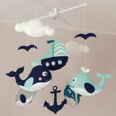 Nautical baby crib mobile. An ideal gift for a new babys nursery or for room decor in an older childs bedroom.  This mobile consists of four whales