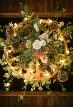 Underside view of wagon wheel chandelier / http://www.deerpearlflowers.com/rustic-country-wagon-wheel-wedding-ideas/2/