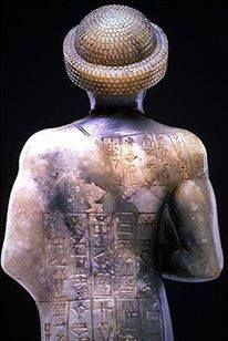 """Back of the statue of """"Gudea of Lagash,"""" (ruled 2141-2122 B.C.E.)  Mesopotamian, Neo-Sumerian period, Iraq A Sumerian cuneiform inscription on the back describes the building of a temple to the goddess Geshtinanna, consort of Gudea's personal god, and the making of this statue for her"""