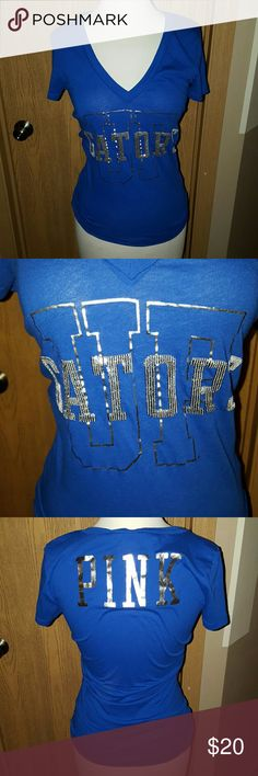 VICTORIA'S SECRET PINK GATORS TEE Super cute Victoria's secret university of FL Gators tee sz XS. Tee only worn once, in amazing shape, no damage. Top is a beautiful cobalt blue color, silver foil lettering along with sequined letter detail. Pictures honestly don't do this top justice!! PINK Victoria's Secret Tops Tees - Short Sleeve