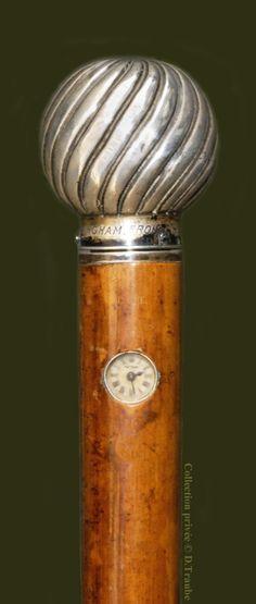 Canne-montre de Holuska en argent massif montée sur jonc de malacca - Le pommeau sert de remontoir - Vienne fin XIXè S.