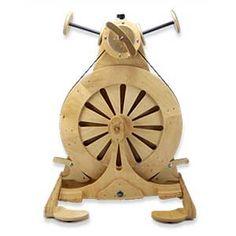 SpinOlution Mach II Spinning Wheel.  Fast, quiet, BiG bobbin, all yarrn types.  What's not to love?