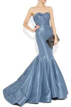 I love the color. This would be a perfect red carpet dress