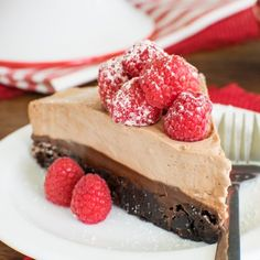 Three layers of chocolate and fresh raspberries make this one awesome brownie cake.