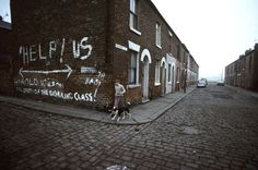 John Bulmer - Manchester (1977) This photograph was taken a year after Harold Wilson's resignation. After serving two terms as prime minister at a time of economic crisis, he had come to be regarded as a champion of the working classes. But his handling of an official strike by the Seamen's Union, together with his economic measures, changed the opinion of many