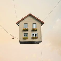 Flying Houses series - a collection of fantastical buildings, homes, tents and trailers removed from their backgrounds and suspended in the sky as if permanently airborne