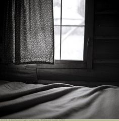 Window and Curtain by Bed