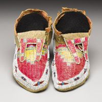 A PAIR OF HIDATSA QUILLED AND BEADED HIDE MOCCASINS c. 1910