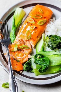 Sweet and Spicy Baked Salmon is super easy, baked on a sheet pan with an easy glaze made with only three ingredients: sweet red chili sauce, sriracha, and fresh ginger. #salmon #easysalmon #glazedsalmon Salmon And Shrimp, Spicy Salmon, Glazed Salmon, Ginger Salmon, Fresh Ginger, Asian Salmon, Oven Baked Salmon, Healthy Cooking, Cooking Recipes