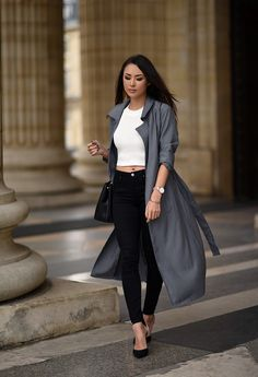 gray coat with white top and black skinny jeans