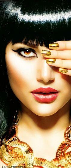 makeup + hair + gold.