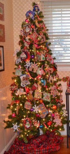 A beautiful tree loaded with the cutest needlepoint ornaments by various designers. One lucky family for sure.