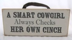 A Smart Cowgirl Always Checks her Own Cinch Sign Organic Ink Free Shipping. $24.99, via Etsy.