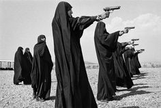 IRAN. Tehran. 1986. Veiled women practice shooting on the outskirts of the city. Jean Gaumy