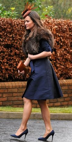 Pippa Middleton, the sister of the Duchess of Cambridge wore a blue dress for the ceremony at St Philip and St James in Holywood, County Down