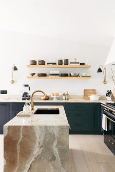 wood floating shelves in kitchen, waterfall kitchen island