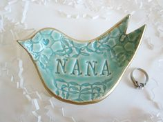 A special gift for Nana, this dove jewelry holder is a place for her to put her rings and earrings when not wearing them. She will love it. Mothers day. Wedding gift for Nana Christmas gift Birthday gift Just because you love Nana gift Size: 5 long by 3 wide Color:mint green Crackle with gold rim See all my artwork at: http://DarriellesClayArt.etsy.com Enjoy and happy shopping.