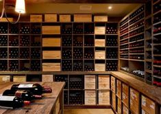 Wine cellar using square designs rather than individual bottle storage - might be easier to DIY and perhaps cheaper too. In any event some storage like this would be useful for cases and case lots Wine Shelves, Wine Storage, Wine Cellar Basement, Bar A Vin, Home Wine Cellars, Building A Garage, Wine Cellar Design, Colored Ceiling, Shelf Design