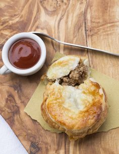 Australian Meat Pie ~ Lucia's pies look so enticing mmm! Ground beef, medium onion, beef broth, ketchup, worcester sauce, dried oregano, grated nutmeg, salt and pepper, flour, puff pastry, egg
