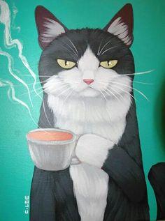 Cat drinking coffee