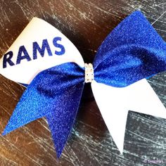 White and royal blue glitter cheer bow.