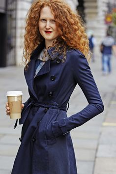 Dress Your Best On The Weekend. A navy trench, red lipstick, and a warm drink.