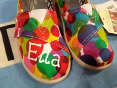 $74 Custom Tiny TOMS Shoes on Red Clea Canvas. Design them on any design or style TOMS has to offer! #custom #toms #tomsshoes #painted #rainbow #polkadot