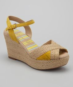 dabec611f12 Defy gravity in these stylish wedge sandals that keep those freshly painted  toes hovering above the