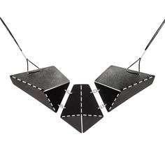 Handmade necklace from black stainless steel and silver, hanging on silicone.
