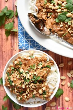 Slow Cooker Thai Chicken with Peanut Sauce ~ features tender chicken stewed in a flavor-infused coconut milk/peanut sauce, served over rice or rice noodles, and garnished with chopped peanuts and cilantro | FiveHeartHome.com