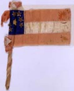 """7-star First National pattern bible flag given to Jane (Mrs. Bradley T.) Johnson of Maryland while riding by train to rejoin troops at Manassas, Virginia July 1861. The flag 3"""" x 5"""" with attached stick. Museum of the Confederacy Collection."""